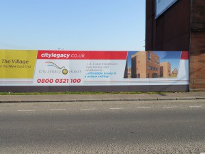 Branded hoardings for the Glasgow Commonwealth Legacy Home project